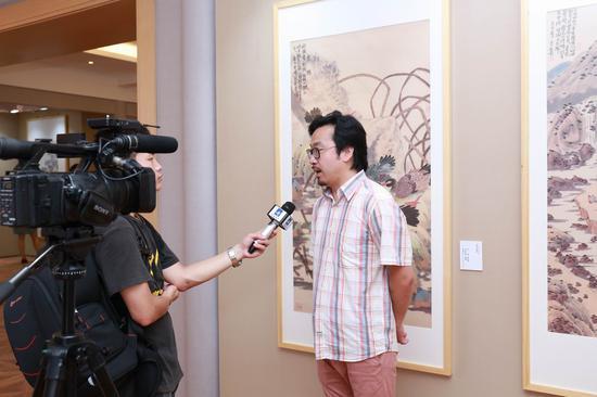 展览总策划、共和社文化艺术机构执行董事王凯接受采访